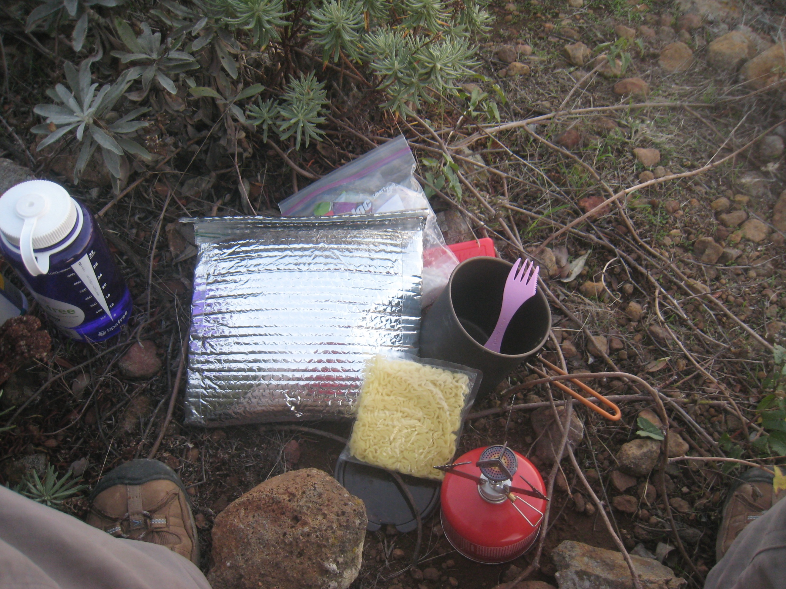 Camp kitchen: MSR Pocket Rocket & solo pot, pink spork, & homemade cozy