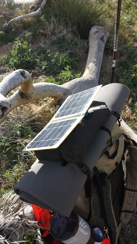 My solar charger, velcroed to the top of my pack