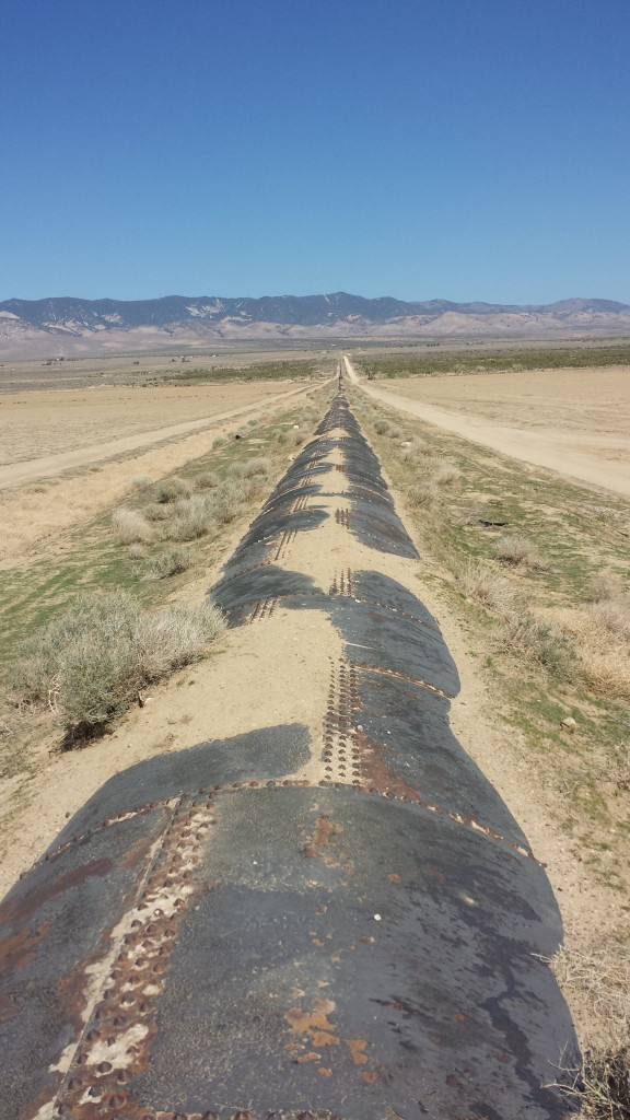 Walking along the spillway pipe