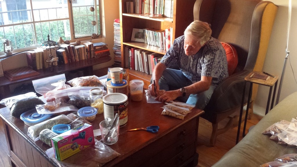 Putting Dad to work assembling dehydrated meals.